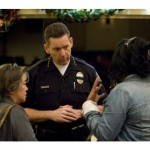 Irvine Police Chief Dave Maggard & Commissioner Chor-Swang Ngin listen to community member