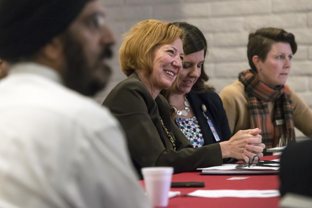 Orange County Sheriff Sandra Hutchens, centerm shares a laugh with religious leaders during Monday's bi-monthly meeting of the O.C. Sheriff's Interfaith Advisory Council at the Sikh Center of Orange County's Gurdwara in Santa Ana. The O.C. Sheriff's Interfaith Advisory Council was formed recently to develop a more formal relationship with faith leaders in the county. The aim is to foster better understanding and trust between law enforcement and people in various faith communities. They held their first bi-monthly meeting in January at the sheriff's training academy. ///ADDITIONAL INFO: interfaithcouncil.03XX - 3/14/16 - PHOTO BY JOSHUA SUDOCK, STAFF PHOTOGRAPHER - The O.C. Sheriff's Interfaith Advisory Council was formed recently to develop a more formal relationship with faith leaders in the county. The aim is to foster better understanding and trust between law enforcement and people in various faith communities. They held their first bi-monthly meeting in January at the sheriff's training academy. On Monday they gathered at the Sikh Center of Orange County's Gurdwara in Santa Ana. Picture made at the Sikh Center of Orange County's Gurdwara in Santa Ana, California on Monday, March 14, 2016.