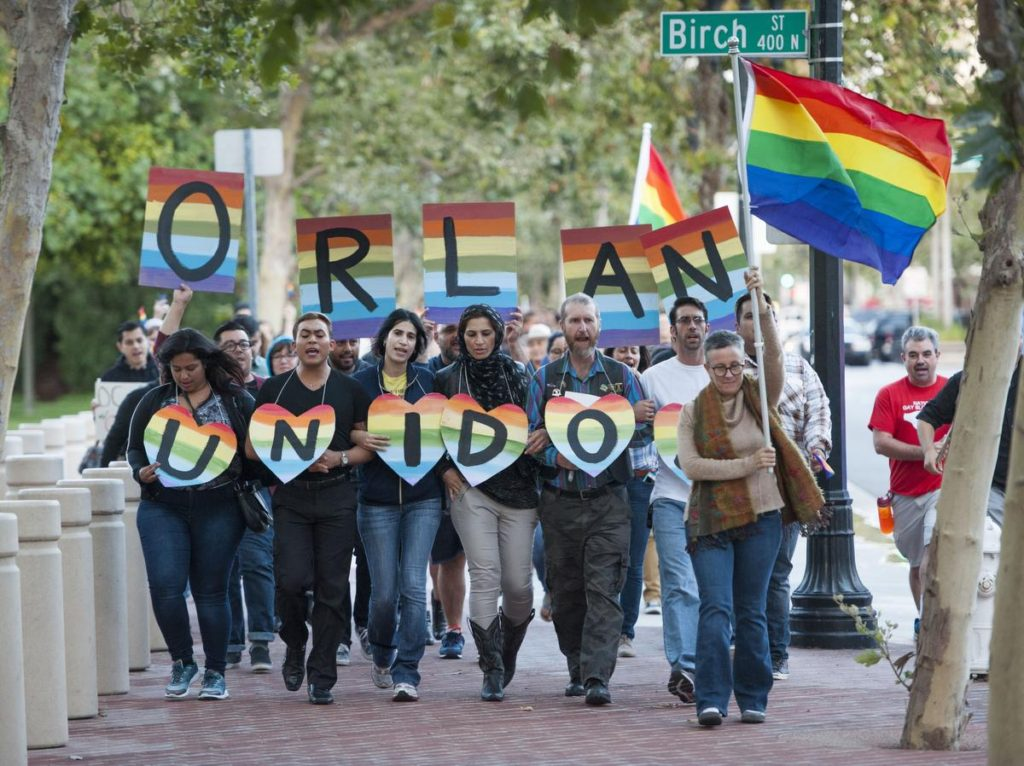 Several hundred supporters, led by Laura Kanter, at right, marched to Sasscer Park after a vigil at Calle Cuatro Plaza in support of the Orlando shooting victims Sunday night in Santa Ana. ///ADDITIONAL INFO: SA.OrlandoVigil.0613.kjs --- Photo by KEVIN SULLIVAN / Orange County Register -- 6/12/16 A vigil for Orlando in downtown Santa Ana by the LGBT Center OC. Also marching to nearby Sasscer Park and then back to Calle Cuatro Plaza.