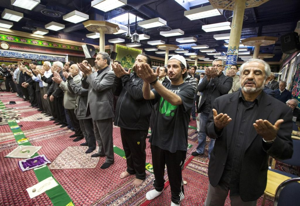 Abdullah Shahsamand, right, of Mission Viejo, join others in a noon prayer service at The Islamic Educational Center of Orange County. //ADDITIONAL INFORMATION: muslim.rally.1212 - 12/11/15 – ED CRISOSTOMO, ORANGE COUNTY REGISTER --  muslim.rally.1212CCI ID Code:B64850344Z.1  Tomorrow, December 11th 2015, the Newport Mesa Interfaith Council will be joining the Muslim community at the Islamic Educational Center of Orange County to rally in solidarity with Muslims and against bigotry.  In light of recent events and political rhetoric against Muslims, it is crucial that we support this cause and continue to show our peaceful and integral role in the American society.
